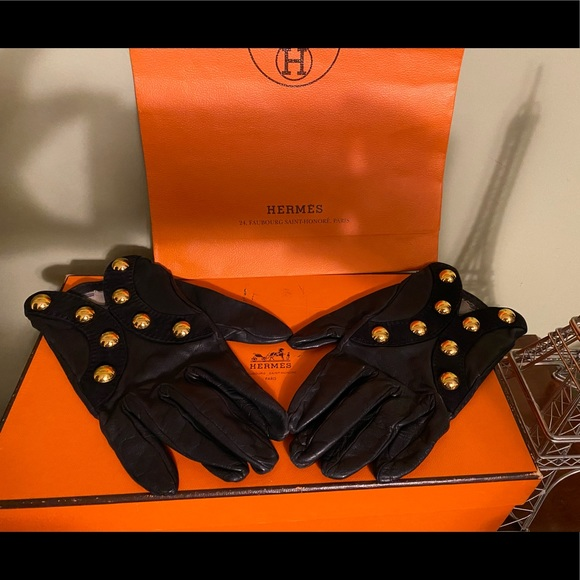Hermes black leather gloves with chic gold design